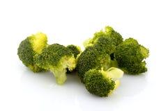 Broccoli pieces. Isolated on white Stock Photos