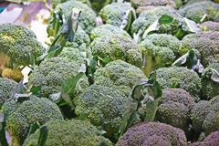 Broccoli in a pile on a market stock image