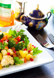 Broccoli and pineapple salad. A plate of delicious broccoli and pineapple salad. Ingredients include pineapple, broccoli, cauliflower, carrots, pomegranate Royalty Free Stock Image
