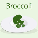 Broccoli at the plate cooked for the detox menu at the light green background. With drawn word Broccoli Royalty Free Stock Image
