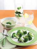Broccoli on plate, in soup and in desser Royalty Free Stock Photography
