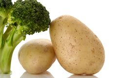 Broccoli and potatoes. Fresh broccoli and potatoes over white background Royalty Free Stock Image
