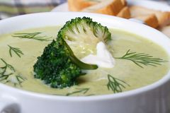 Broccoli puree soup with dill macro. Horizontal Stock Photos