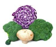Broccoli, purple cabbage and mushroom. On white Stock Photo