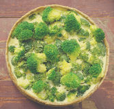 Broccoli quiche, tart with cheese and cream Stock Photos