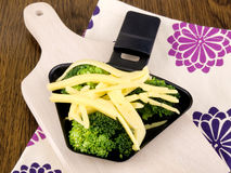 Broccoli with raclette cheese Royalty Free Stock Images