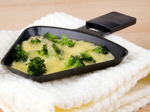 Broccoli with raclette cheese Royalty Free Stock Photos