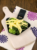Broccoli with raclette cheese Stock Photos