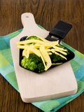 Broccoli with raclette cheese Royalty Free Stock Photography