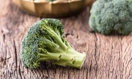 Broccoli.Raw fresh broccoli on old wooden table Stock Photos