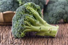 Broccoli.Raw fresh broccoli on old wooden table Stock Images