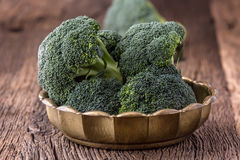 Broccoli.Raw fresh broccoli on old wooden table Royalty Free Stock Photography