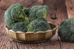 Broccoli.Raw fresh broccoli on old wooden table Royalty Free Stock Photos