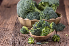 Broccoli.Raw fresh broccoli on old wooden table Royalty Free Stock Image