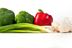 Broccoli, red bell pepper, green onions. Royalty Free Stock Photography