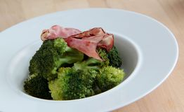 Broccoli with roasted bacon. Broccoli with roasted bacon served as a salad or side dish Stock Photography