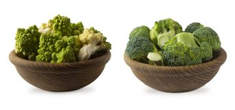 Broccoli and Roman cauliflower in wooden bowl isolated on white background. Cauliflower close up. Fractal texture of romanesco broccoli. Roman cauliflower with Royalty Free Stock Photo