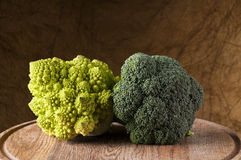 Broccoli and romanesco cauliflower on a wooden cutting board. Studio shot Royalty Free Stock Image