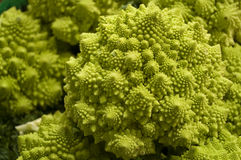 Broccoli romanesco. A close-up shot of broccoli romanesco and its spiral-shaped patterns stock photo