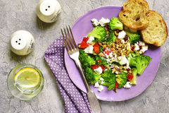 Broccoli salad with bell pepper,feta and walnuts with yougurt dr Royalty Free Stock Images