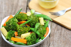 Broccoli salad with carrot ,baby corn and snap pea Royalty Free Stock Photos