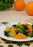 Broccoli salad. Delicious broccoli salad with tomato, garlic and orange Stock Photography