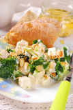 Broccoli salad with feta and almonds Stock Photos