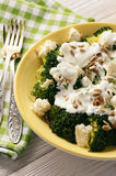 Broccoli salad with feta cheese, garlic dressing and sunflower seeds. Stock Photo