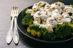 Broccoli salad with feta cheese, garlic dressing and sunflower seeds. Royalty Free Stock Images