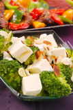 Broccoli salad with feta and flaked almonds. Healthy broccoli salad with feta and flaked almonds Royalty Free Stock Photography