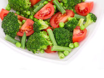 Broccoli salad with french beans and tomatoes. Royalty Free Stock Photo