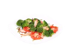 Broccoli salad with pumpkin seeds and tomatoes. Royalty Free Stock Photos