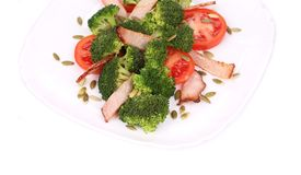 Broccoli salad with pumpkin seeds and tomatoes. Stock Photos