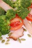 Broccoli salad with pumpkin seeds and tomatoes. Stock Image