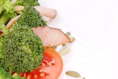 Broccoli salad with pumpkin seeds and tomatoes. Royalty Free Stock Photography