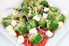 Broccoli salad with tomatoes and cheese Stock Image