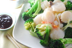 Broccoli scallop. Chinese cuisine fired broccoli scallop royalty free stock photos