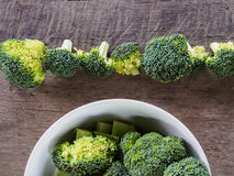 Broccoli set on wooden. Background Royalty Free Stock Photography