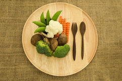 Broccoli , shitake mushroomand green pea on wooden dishware Stock Images