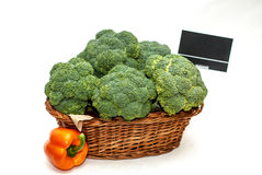 Broccoli in a shop basket. Shop basket full of broccoli and a pepper Royalty Free Stock Photography
