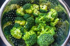 Broccoli in a sieve stock photo