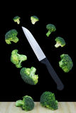 Broccoli slices and knife floating Stock Photos