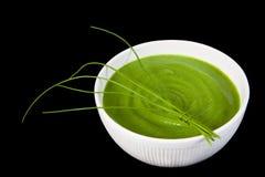 Broccoli soup. White bowl of broccoli soup on black background Royalty Free Stock Photo