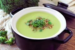 Broccoli soup in black and white bowl, close up scene Stock Image