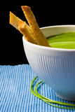 Broccoli soup and bread. Broccoli soup with three pieces of bread stock images
