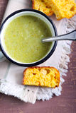 Broccoli soup. In a mug and cheese bread royalty free stock images
