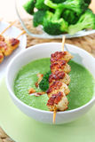 Broccoli soup with skewered chicken Royalty Free Stock Image