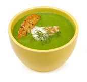 Broccoli soup in yellow bowl Royalty Free Stock Photography