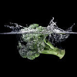 Broccoli splash Stock Photos