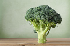 Broccoli Standing on Wood with Green Background Royalty Free Stock Photo